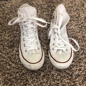 Worn-in White Converse High-Tops